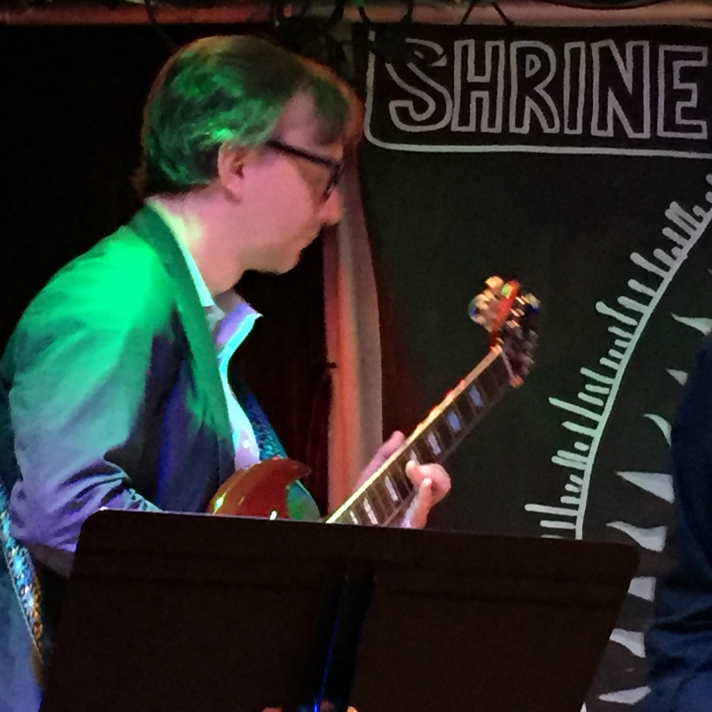Chester Jankowski playing jazz guitar at Shrine Jazz Club in New York City.
